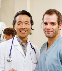 doctor and his student smiling